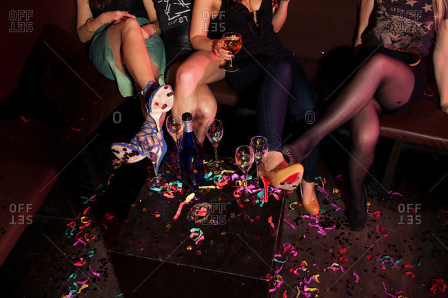 Female mini skirted friends in nightclub