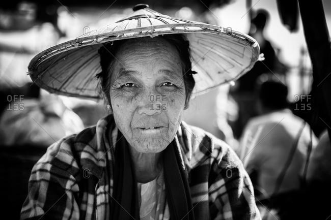 Inle Lake, Myanmar - February 2, 2015: Senior Asian woman wearing conical hat