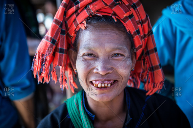 Inle Lake, Myanmar - February 2, 2015: Portrait of Asian woman with red scarf on her head