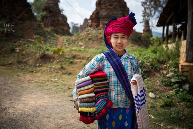 Inle Lake, Myanmar - February 2, 2015: Girl carrying colorful cloths
