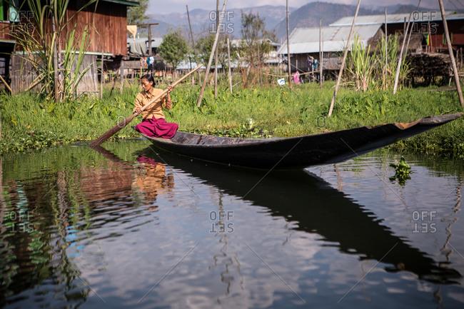 Inle Lake, Myanmar - February 2, 2015: Woman paddling on a boat on Inle Lake