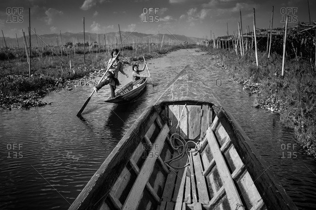 Inle Lake, Myanmar - February 2, 2015: Children rowing a boat on Inle Lake