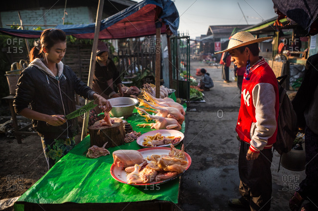 Inle Lake, Myanmar - February 3, 2015: Woman preparing turkey to sell in a market
