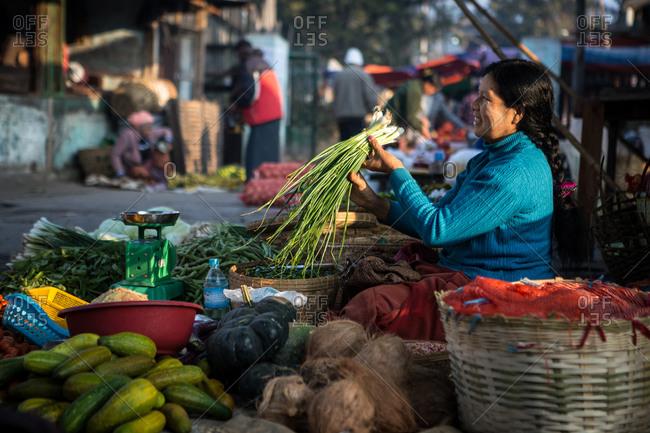 Inle Lake, Myanmar - February 3, 2015: Woman vegetables in a market