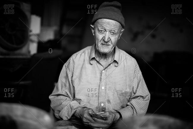 Beirut, Lebanon - November 6, 2015: Portrait of an old man wearing a knit hat