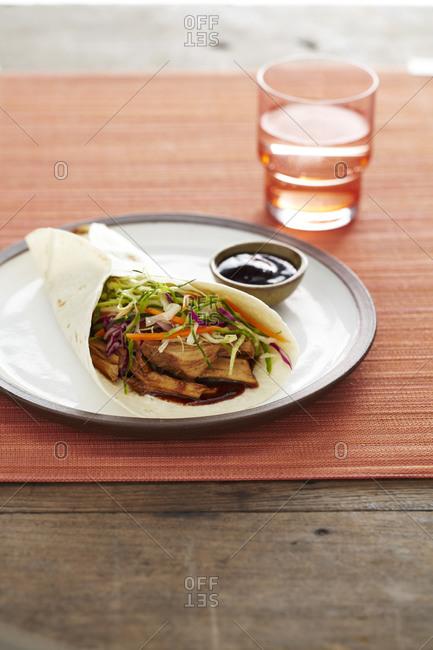 Pork wrap with sesame slaw
