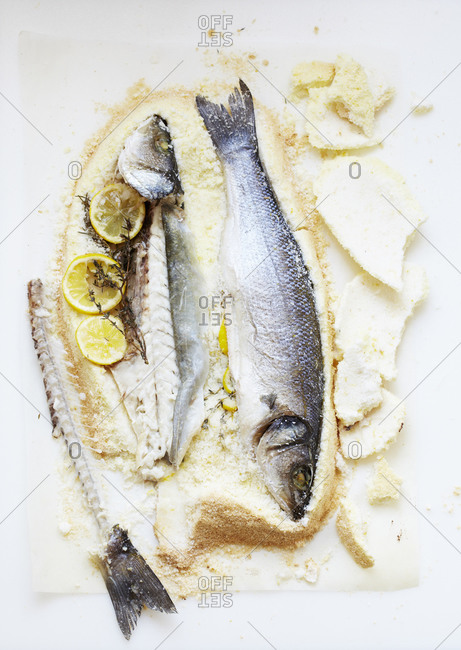 Whole branzino fish baked in salt with lemon and thyme