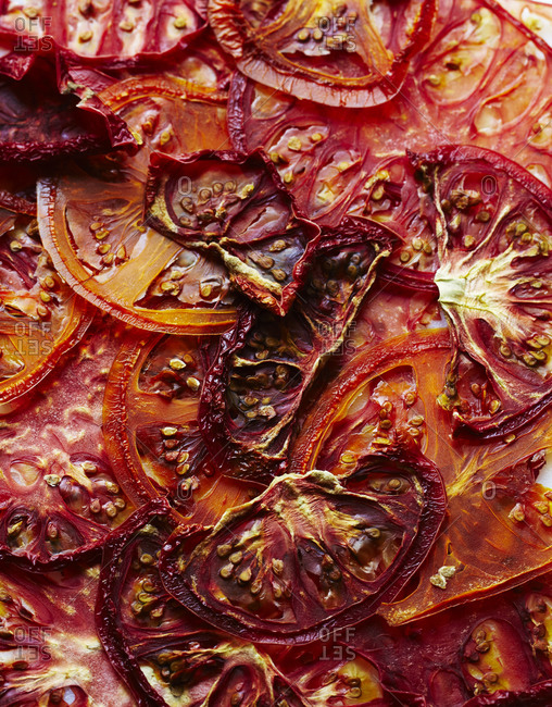 Overhead view of sliced roasted heirloom tomatoes