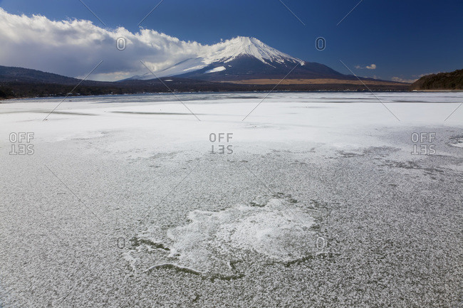 Ice on Lake Yamanaka with a snowcapped Mount Fuji in the background