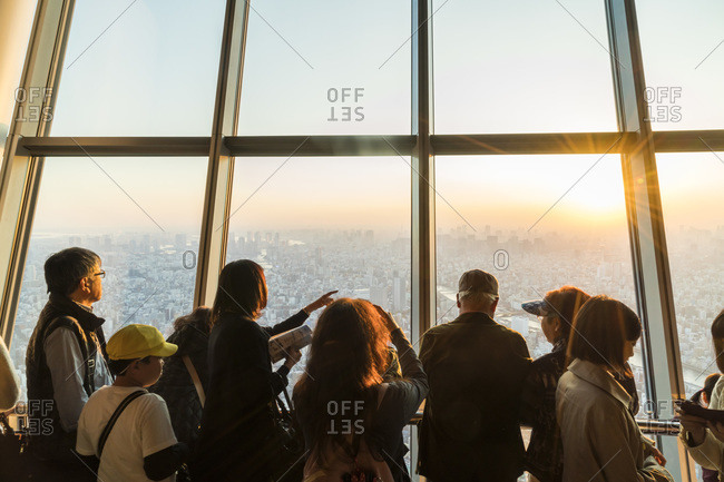 Tokyo, Japan - November 6, 2015: People looking out over Tokyo from an observation deck in the Tokyo Skytree in Japan