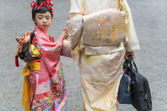 Tokyo, Japan - November 7, 2015: Mother and daughter in traditional Japanese dress in Tokyo, Japan
