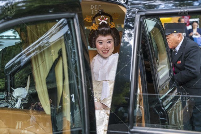 Tokyo, Japan - November 7, 2015: Bride in traditional wedding dress sitting in a chauffeur-driven car in Tokyo, Japan