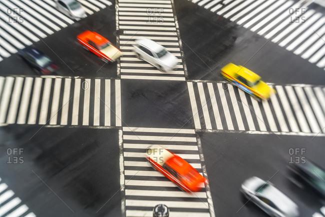 Cars driving across Sukiyabashi crossing, Ginza, Tokyo, Japan