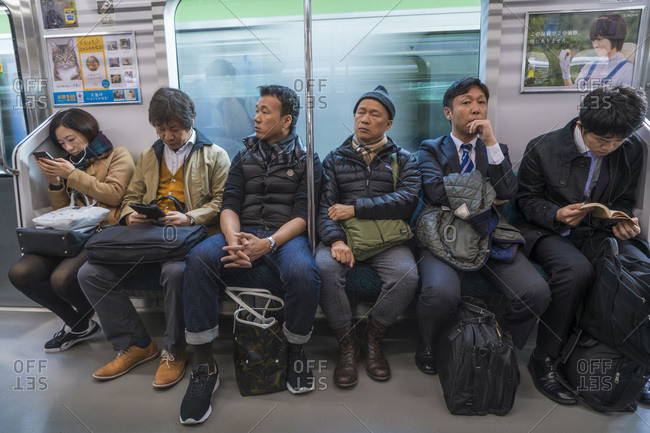 Tokyo, Japan - November 30, 2015: Commuters on a subway train in Tokyo, Japan,