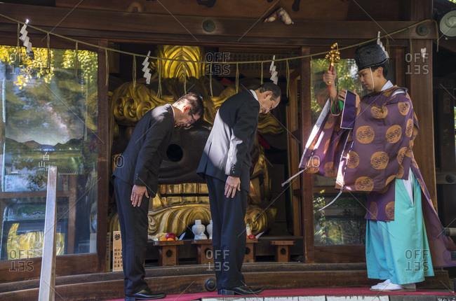 Tokyo, Japan - December 1, 2015: Businessmen receiving blessing before work at a Shinto temple in Tokyo, Japan