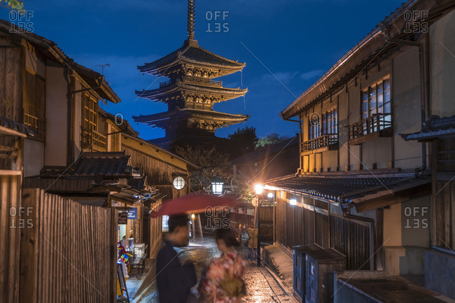 Couple outdoors in the evening near the Yasaka Pagoda, Kyoto, Kyoto Prefecture, Japan