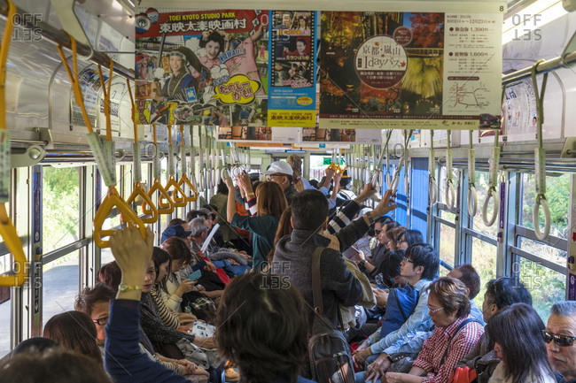 Tokyo, Japan - November 16, 2015: Commuters on a Tokyo metro train carriage in Tokyo, Japan