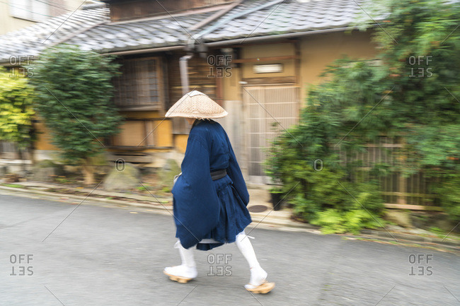 Shinto monk walking along the street in Kyoto, Japan