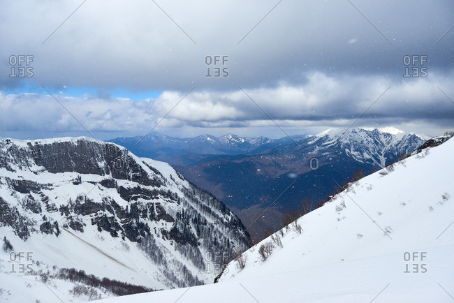 Overlooking scenic mountain range with snow