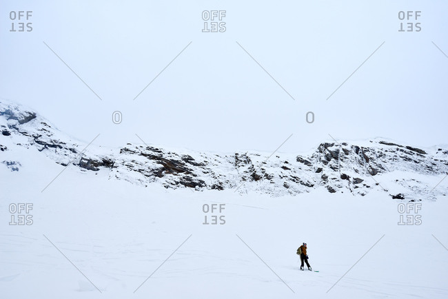 Woman snowboarding down a slope