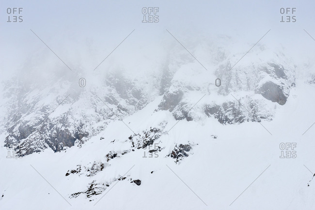 Fog covered mountains in the snow