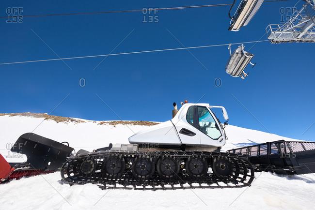 Trail grooming equipment at ski slope