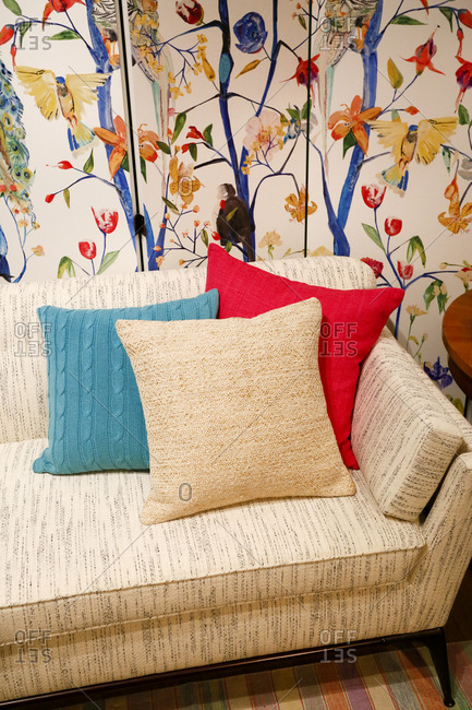Sofa in a living room with colorful wallpaper