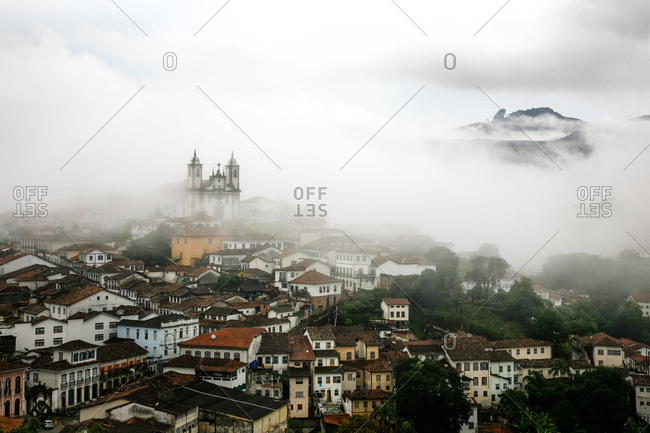 Fog settling over the town of Ouro Preto and Our Lady of Mount Carmel Church in the Mina Gerais State in Brazil