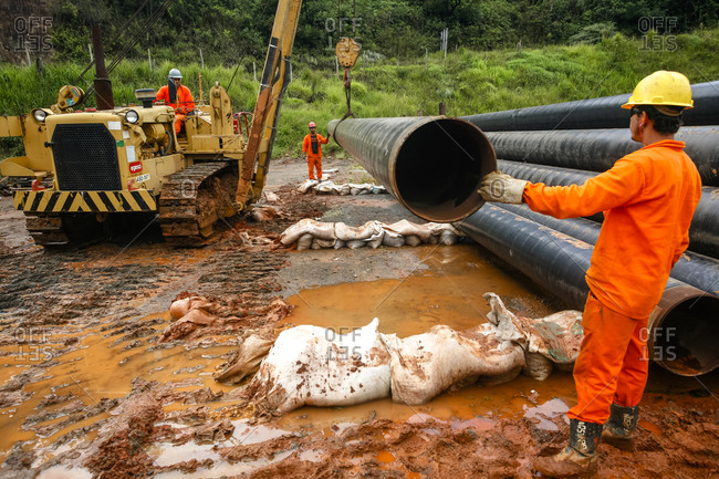 Congonhas, Brazil - March 5, 2010: Workers laying a natural gas pipeline