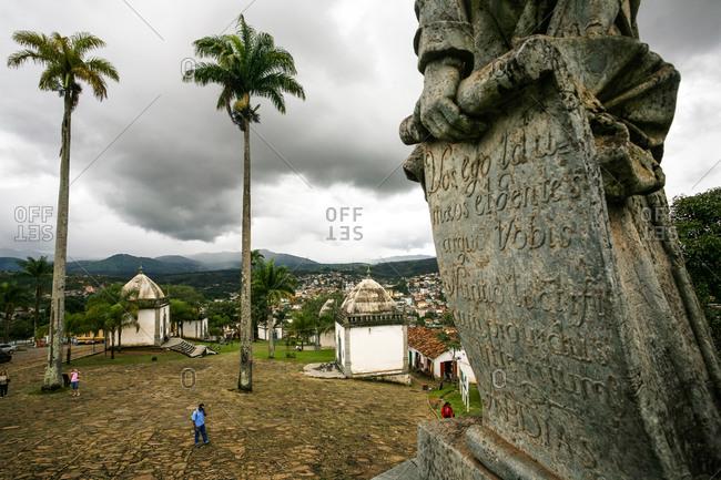 Twin chapels and the statue of the prophet Jeremiah by Aleijadinho at the Basilica do Bom Jesus de Matosinhos in Congonhas, Minas Gerais, Brazil