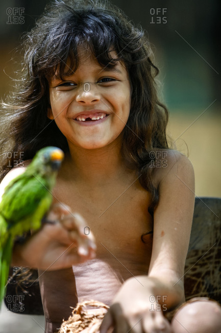 Porto Seguro, Brazil - March 19, 2010: Portrait of young Pataxo Indian girl at the Reserva Indigena da Jaqueira