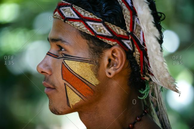 Porto Seguro, Brazil - March 19, 2010: Profile of a Pataxo Indian man at the Reserva Indigena da Jaqueira