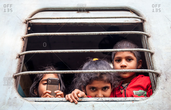 December 26, 2015: Children looking through the window of a train car