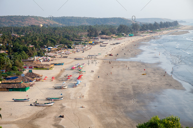 View of a resort area on an expanse of sandy beach