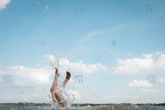 Girl diving into a lake