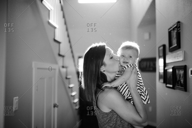 Mother kissing her young child's cheek