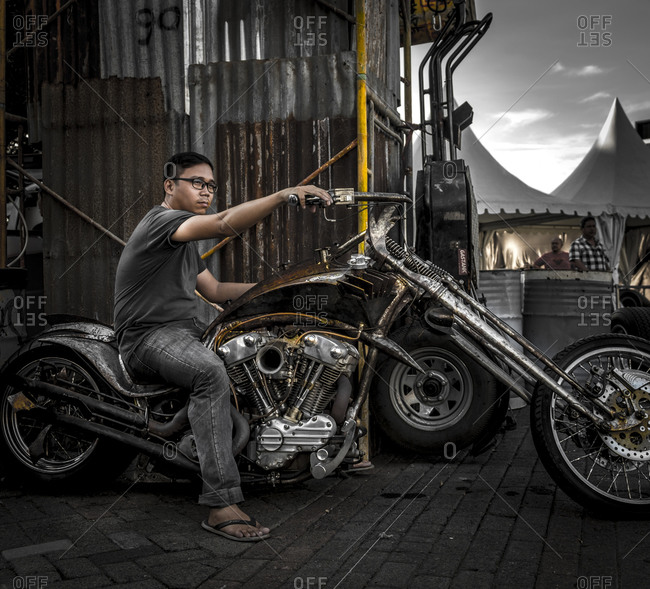 Jakarta, Indonesia - April 12, 2016: Asian man on a motorcycle