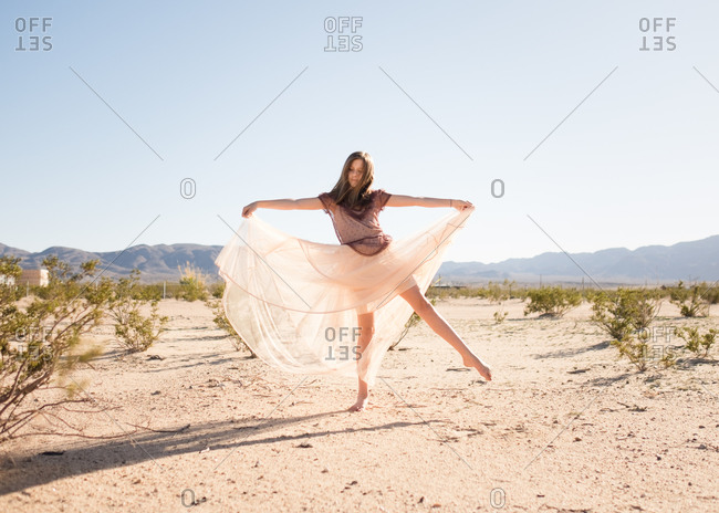 Young female posing in the desert