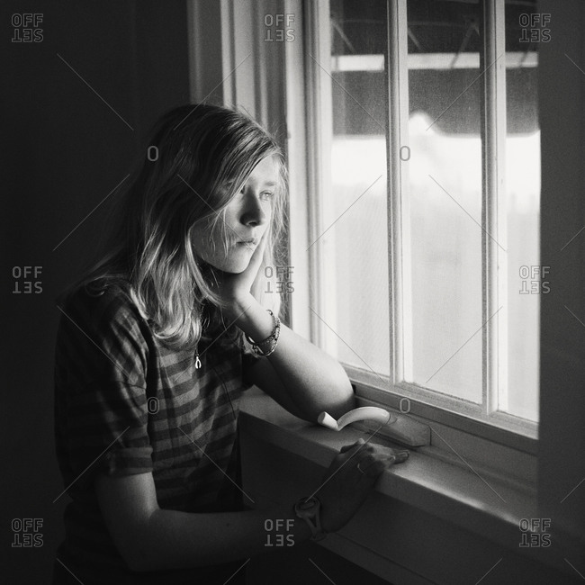 Girl looking at the window