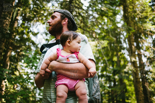 Man holding baby girl in the forest