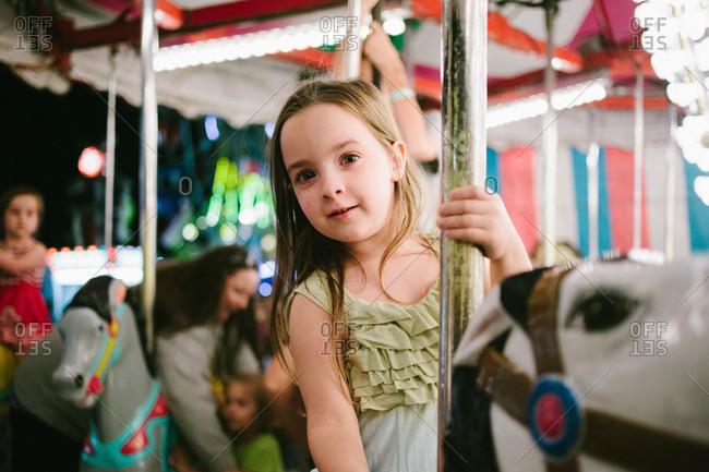 Child on an amusement ride at a fair