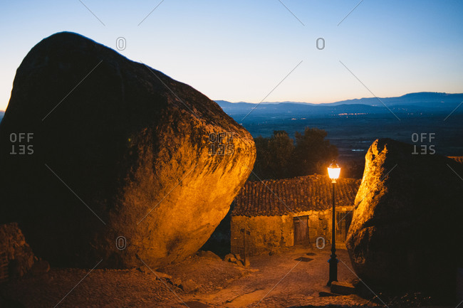 Homes built among boulders at night in Monsanto, Portugal