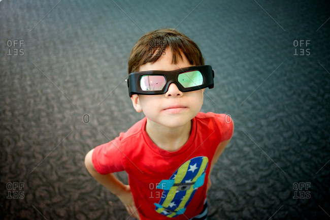 Portrait of a boy wearing a t-shirt and 3-D glasses