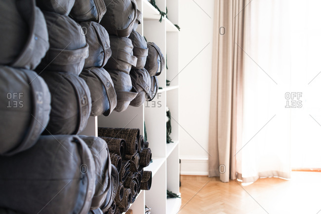 Shelves of yoga equipment at a studio