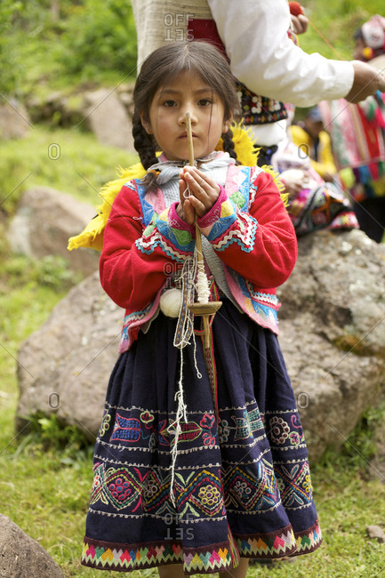 Peru - April 5, 2013: Portrait of a Peruvian girl rolling a ball of yarn