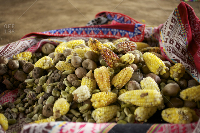 Peruvian feast of corn, potatoes and beans on blanket