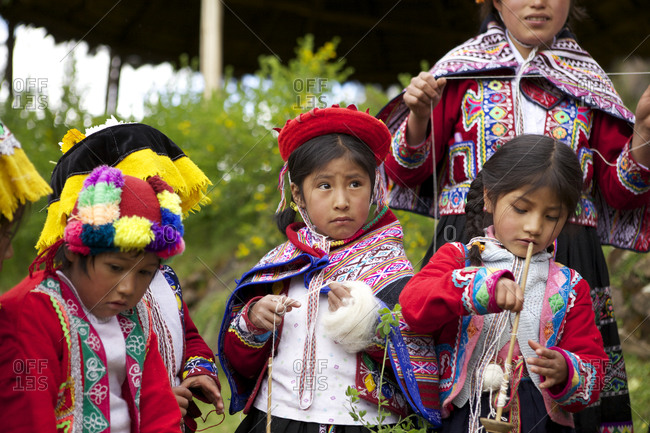 Peru - April 5, 2013: Young children in the Amaru community with wool yarn