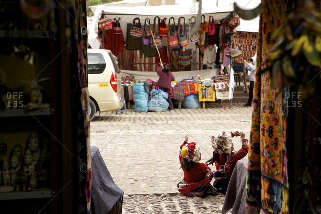 Two little girls in traditional dress at Pisac Market, Cusco, Peru