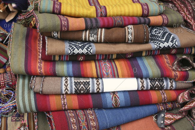 Stack of Andean rugs for sale in the Chinchero community, Cusco, Peru
