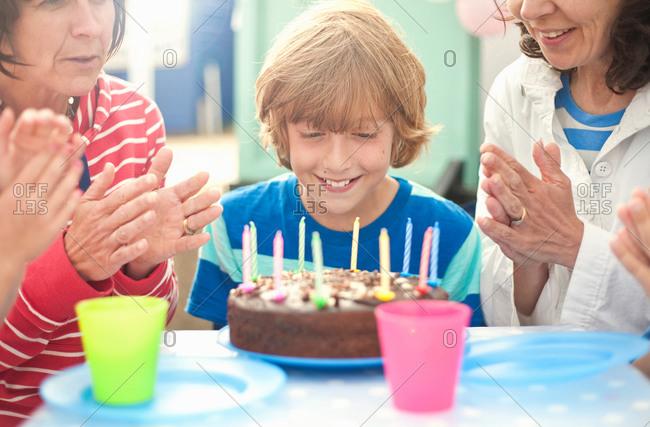 Mother and children enjoying birthday celebration